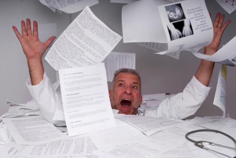 doctor-drowning-in-paper